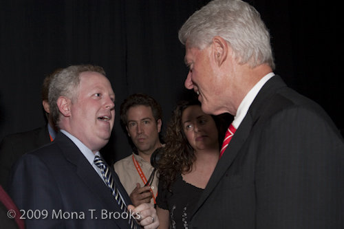 Adam Bonin shakes hands with former US president Bill Clinton