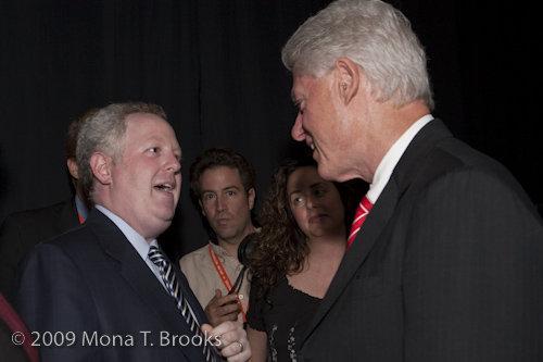 Adam Bonin shakes hands with former US president Bill Clinton